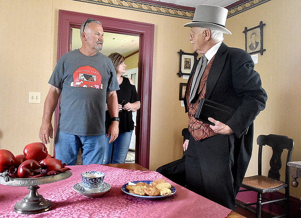 (Brad Davis/The Register-Herald) Visitors Tim Martin and wife Andrea have a chat with Alfred Beckley himself, a.k.a. Gerald Godfrey, after encountering him while touring through Wildwood House, the former home of and now museum dedicated to the Beckley's during Founder's Day festivities Saturday afternoon.