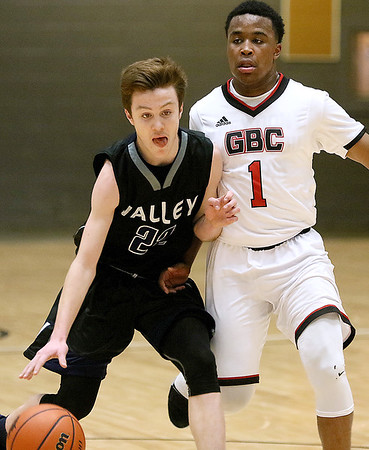 (Brad Davis/The Register-Herald) Valley's Nick Gipson tries to get around Greater Beckley Christian's Caleb Clark during the Class A Region 3 Co-Final Thursday night at the Beckley-Raleigh County Convention Center.