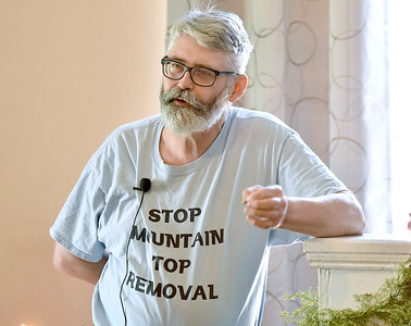 (Brad Davis/The Register-Herald) Coal River Mountain Watch's Vernon Haltom describes flooding issues that residents commonly face along the Coal River area around Naoma and surrounding communities due to the effects of mountaintop removal mining during a public event at New River Unitarian Universalist Fellowship Sunday morning.