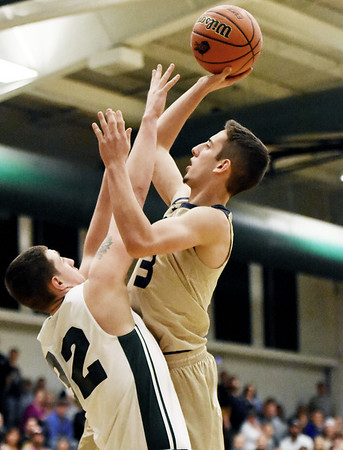 Shady Spring's Colton Honaker goes up for a shot over Wyoming East's Dylan Brehm during their Class AA Region 3 Conference Final Wednesday in New Richmond. (Chris Jackson/The Register-Herald)