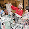 Suzette Peterson, of Daniels, second from left, and Tammy Spurgeon, look over clothing items at Wendy's Jewels by Design booth during the Womans Expo held at Beckley-Raleigh County Convention Center Friday afternoon. This is a two day event with 120 vendors displaying their products.<br /> (Rick Barbero/The Register-Herald)