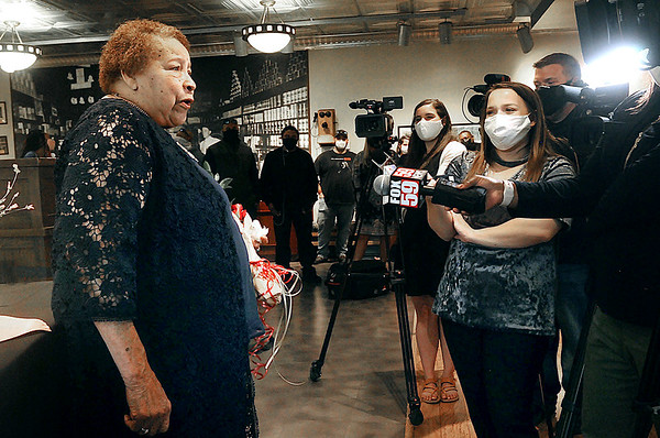 Zora Stroud entertains the media with tales about her service as an African-American female coal miner at the Rahall Company Store museum at the WV Exhibition Coal Mine. Jon C. Hancock/for The Register-Herald