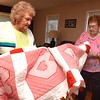 Zetta Underwood, 92, right, and Margaret Williams, 70, looks over a quilt Margaret made.<br /> (Rick Barbero/The Register-Herald)