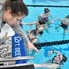 (Brad Davis/The Register-Herald) Head coach Robin Feldhake, left, talks with her Flying Eagle swimmers as a practice session gets underway Friday afternoon at the YMCA of Southern West Virginia.