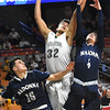 Darrick McDowell, of Fayetteville, center, drives to the basket againat, Chase DiBartolomeo, left, and Hunter Payne of Madonna, during the Class A quarter final game of the Boys State Basketball Tournament held at the Charleston Civic Center Wednesday morning. Madonna handed three-seed Fayetteville its first loss of the season 44-32, <br /> (Rick Barbero/The Register-Herald)