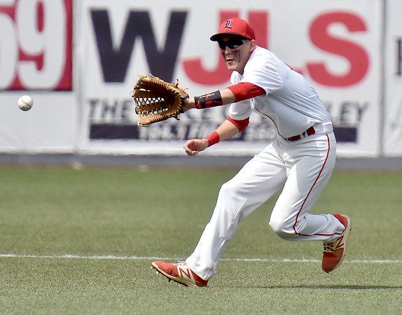 (Brad Davis/The Register-Herald) Liberty's Logan Williams fields a ground ball against Westside Tuesday afternoon at Linda K. Epling Stadium.