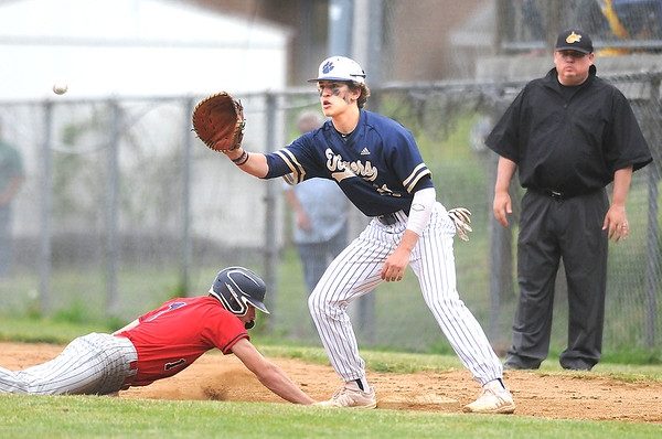 Independence's Cyrus Goodson slides back into first base ahead of the throw to Shady first baseman Adam Richmond. Jon C. Hancock/for The Register-Herald
