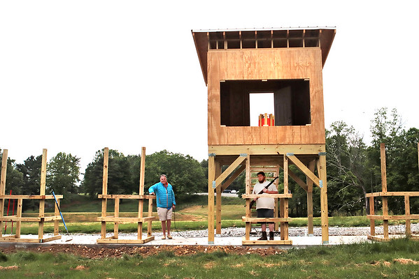 Shooting range specialist Brandon Buckland stands under the wobble thrower tower at the new Adventure Zone in Pipestem Resort State Park Saturday. The Adventure Zone offers 3D Archery, Miniature Golf, Disc Golf, Remote-Controlled Cars and Trucks, Drone Flying, Laser Tag, Skeet Shooting and Motor Assisted Mountain Bikes. The Adventure Zone is open seven days a week and all equipment is provided. Jenny Harnish for the Register-Herald