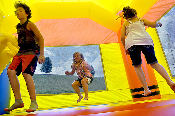 (Brad Davis/The Register-Herald) Youngsters jump around in a giant inflatable during the Kid's Quest Carnival Saturday morning at Marquee Cinemas