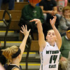 (Brad Davis/The Register-Herald) Wyoming East's Jazz Blankenship shoots from three-point range as Westside's Riana Kenneda defends Thursday night in New Richmond.