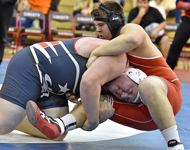 (Brad Davis/The Register-Herald) Independence's Tyler Walton Jr. takes on Man's D.J. Browning in a 285-pound weight class matchup Saturday afternoon at the Raider Rumble in Glen Daniel.
