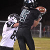 (Brad Davis/The Register-Herald) Wyoming East receiver #15 makes a catch as Westside's Dwight Justus defends Friday night in New Richmond.
