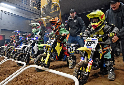 (Brad Davis/The Register-Herald) Young racers focus just before the starting gate drops on a 50cc junior race during the weekend's Tristate MX dirt bike racing event Saturday night at the Beckley-Raleigh County Convention Center.