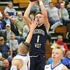 (Brad Davis/The Register-Herald) Greenbrier West's Noah Midkiff shoots from three-point range as Midland Trail's Indy Eades defends Friday night in Hico.