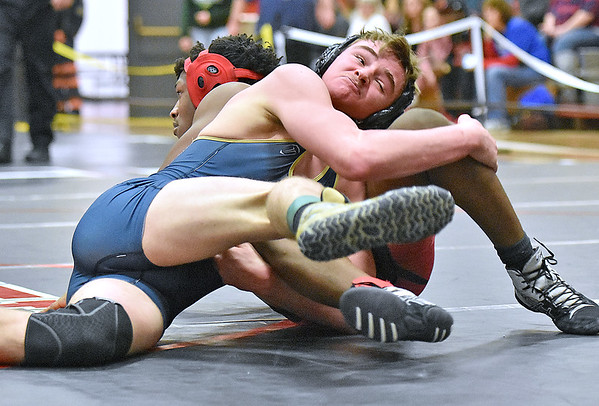 (Brad Davis/The Register-Herald) Shady Spring's Tristan Tate takes on Oak Hill's Rodell Allen in a 152-pound weight class matchup during the Coalfield Conference Invitational Friday night in Oak Hill. Shady's Tate pinned Allen to win the match.