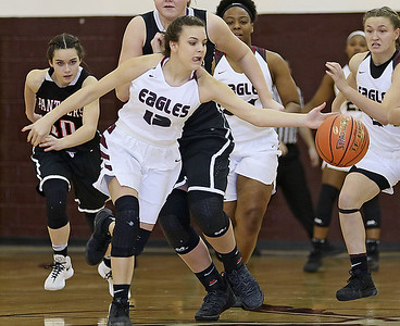 (Brad Davis/The Register-Herald) Woodrow Wilson's Chloe Frantz scoops up a loose ball on the run against PikeView Thursdsay night.