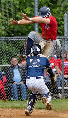 Atticus Goodson of Independence  attempts to jump over Shady Spring  catcher Parker Redden.  Goodson was out on the play, In game 2 of Sectionals Wednesday night.<br /> TINA LANEY/for The Register-Herald