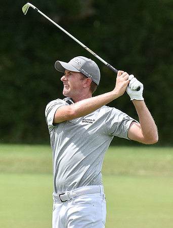(Brad Davis/The Register-Herald) Webb Simpson shoots from the fairway during opening round action of the Military Tribute at The Greenbrier Thursday afternoon in White Sulphur Springs.