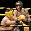 (Brad Davis/The Register-Herald) Oak Hill's Andrew Gunn, right, connects with a right hand against Jumping Branch's James Carroll during the Original Toughman Contest Friday night at the Beckley-Raleigh County Convention Center. Gunn would win the fight.