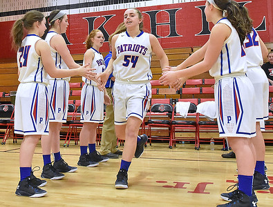(Brad Davis/The Register-Herald) Midland Trail's Laurel Johnson collects high-fives from all her Patriot teammates as she's introduced by the public address announcer prior to their opening round game against Valley (Fayette) in the Region 3, Section 1 tournament Saturday evening at Oak Hill High School.