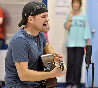 (Brad Davis/The Register-Herald) Coal City resident and local country musician Thomas Danley puts on a special show for youngsters at Coal City Elementary Friday afternoon. Danley, who has played alongside fellow local musician Cody Wickline, may end up taking a crack at The Voice in the future but for now is working on putting together a band and hopes to spend the next year on those efforts.