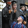 "(Brad Davis/The Register-Herald) Sporting shades, graduate Davis Bockarie, far left, strikes a few poses before he and fellow students who earned their certificates in Computer Systems Repair Technology take the ""for real"" group photo during the Academy of Careers and Technology's 2018 awards and graduation ceremony Thursday evening at the Beckley-Raleigh County Convention Center."