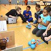 "Audrey Williams, technology intergration specialist Raleigh County School, left, works with, Eric Miller, Antonasia Scruggs, Myava Watson and Jagger Hodge, second graders, during a Legacy Lab class at Cranberry-Prosperity School. They are working at one of the four stations called, ""Dash's Bssketball."" Cranberry Prosperity has been awarded with the status of being an ""Apple Distinguished School"" for being top notch with technology use in their classrooms.<br /> (Rick Barbero/The Register-Herald)"