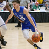 (Brad Davis/The Register-Herald) WVU commit Jordan McCabe drives around Mid-State Ford's Dontarius James as he plays for Team EIN (Employers' Innovative Networks) in the Scott Brown Classic Saturday night at the Beckley-Raleigh County Convention Center.