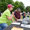 Active SWV Community Captain Charity Wysong, left, speaks with Alan Foster while signing a waiver for the night hike at Grandview as part of Active SWV's and the National Park Service's Get Active in the Park Tuesday in Grandview. (Chris Jackson/The Register-Herald)