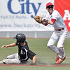 (Brad Davis/The Register-Herald) Liberty shortstop Logan Williams forces out Westside's #4 but wouldn't be able to complete the double play off a ground ball from Westside's #25 Tuesday afternoon at Linda K. Epling Stadium.