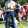 Kevin Na and his caddie line up a putt on the par 5, 12th hole during A Military Tribute at The Greenbrier golf tournament held at The Greenbrier Resort in White Sulphur Springs.<br /> (Rick Barbero/The Register-Herald)