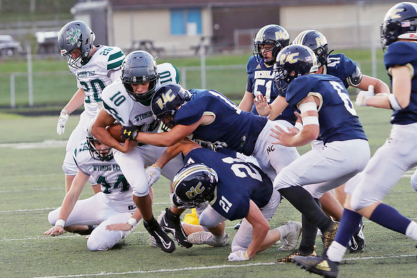 Wyoming East's Chandler Johnson is brought down by Nicholas County players during Friday's game in Summersville. Jenny Harnish/The Register-Herald