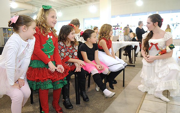 Rick Barbero/The Register-Herald Jenna Meador, as Clara, right, speaks with, Natalie Craddock, left, Camryn Harris, Ava Lilly, Holly Jones and Paetyn Kieth, during the Sugar Plum Fairy Tea Party was held at Lewis Automotive Group, on 100 Appalachian Dr in Beckley Sunday afternoon. Guest enjoyed tea with Clara, the Sugar Plum Fairy and other characters from The Nutcracker. The characters also performed ballet from the show. This was a benefit event for the Heather Zickefoose Scholarship fund to aid talented students to be professional dancers.