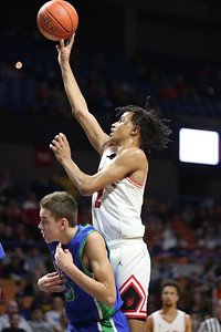 Oak Hill's Michael Beasley puts a shot up over a Robert C. Byrd defender during their West Virginia State Championship Class AA Quarter Finals in Charleston on Thursday. (Chris Jackson/The Register-Herald)