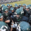 (Brad Davis/The Register-Herald) Wyoming East's Jake Cannady (middle) gets his teammates fired up for cross county rival Westside Friday night in New Richmond.