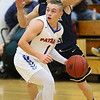 (Brad Davis/The Register-Herald) Midland Trail's Indy Eades looks for an open teammate along the perimeter as Greenbrier West's Noah Midkiff defends Friday night in Hico.