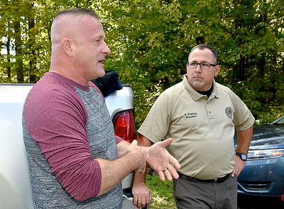 (Brad Davis/The Register-Herald) State senator Richard Ojeda, left, talks with Kevin Franco, President of the American Federation of Government Employees Local 404, and others as he arrives on site at gates of Beckley's Federal Correctional Institution Wednesday afternoon near Beaver.