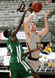 (Brad Davis/The Register-Herald) WVU Tech's Brent Daniels drives to the basket and scores as Point Park's Erat Ojoko defends Saturday night at the Beckley-Raleigh County Convention Center.