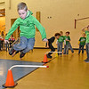 (Brad Davis/The Register-Herald) Kindergartener Landon Frazier clears another obstacle as he jumps away some extra energy during Maxwell Hill Elementary's Jumping for Hearts event Friday afternoon in the school's gymnasium. Students spent several days gathering donations for the American Heart Association by sending out e-mails, asking friends and family or even going door-to-door in their neighborhoods if they wised, raising around $5,000 overall. The annual event concluded with a special celebration in the gym where students got to run and play in a variety of jumping-related activities.