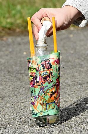 Andrea Treadway, second grade teacher at Sophia Soak Creek Elementary School, loads baking soda wrapped in a paper towel preparing to launch the rocket.<br /> (Rick Barbero/The Register-Herald)