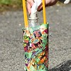 Andrea Treadway, second grade teacher at Sophia Soak Creek Elementary School, loads baking soda wrapped in a paper towel preparing to launch the rocket.<br /> (Rick Barbero/The Register-Herald)