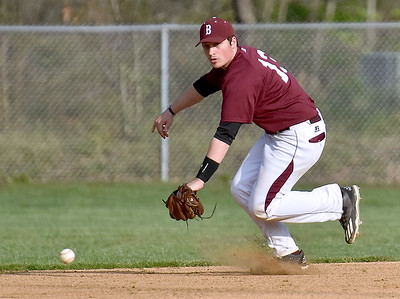 (Brad Davis/The Register-Herald) Woodrow Wilson shortstop Michael Maiolo ranges to his right to field a ground ball during the Flying Eagles' loss to St. Albans Friday evening in Beckley.