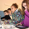 "Aydin Prichett, left, Kholton Toma, Niema Laster and Isabella Templeton, second graders, work at the basketball vocabulary station during a Legacy Lab class at Cranberry-Prosperity School. Cranberry Prosperity has been awarded with the status of being an ""Apple Distinguished School"" for being top notch with technology use in their classrooms.<br /> (Rick Barbero/The Register-Herald)"