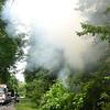 Firemen fight a fire on East Cherokee Street in Sprague Monday afternoon.<br /> (Rick Barbero/The Register-Herald)