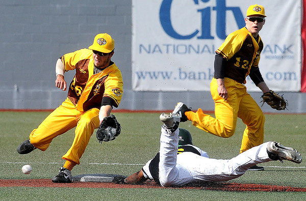 Miners base runner Juan Familia slides into second base in front of the short throw to Millrats second baseman Colby Rockacy, backed up by short stop Jake Williams. Jon C. Hancock/for The Register-Herald
