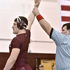 (Brad Davis/The Register-Herald) Woodrow Wilson's Colton Wright is declared the winner of his match with St. Albans' Andrew Vickers in a 220-pound weight class matchup during the Class AAA Regionals Saturady afternoon at Woodrow Wilson High School.