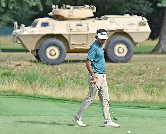 (Brad Davis/The Register-Herald) An army armored personnel carrier sits on display behind the no. 15 green as Bubba Watson and other pro golfers play during the second round of the Military Tribute at The Greenbrier Thursday afternoon in White Sulphur Springs.