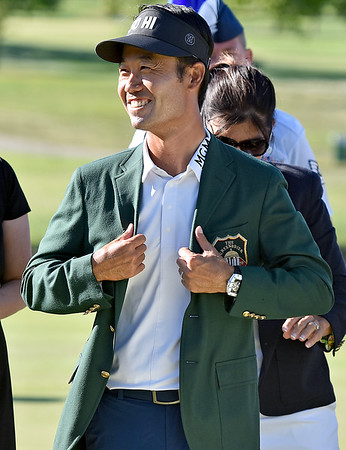(Brad Davis/The Register-Herald) Kevin Na tries on his new green jacket after winning the Military Tribute at The Greenbrier Sunday afternoon in White Sulphur Springs.