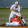 F. Brian Ferguson/Register-Herald St. Albans's Carson McCoy slides into second base below the tag of Oak Hill's Conner Roberts during Tuesday action at Linda K. Eppling Stadium.