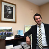 Sam Petsonk, employee lawyer, opening up his new office on 223 Main Street in Beckley.<br /> (Rick Barbero/The Register-Herald)